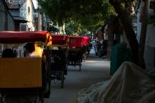 Beijing Hutong rickshaw traffic jam.